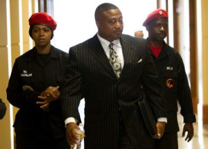 Why won't Quanell X wear the uniform of the group he supposedly leads???