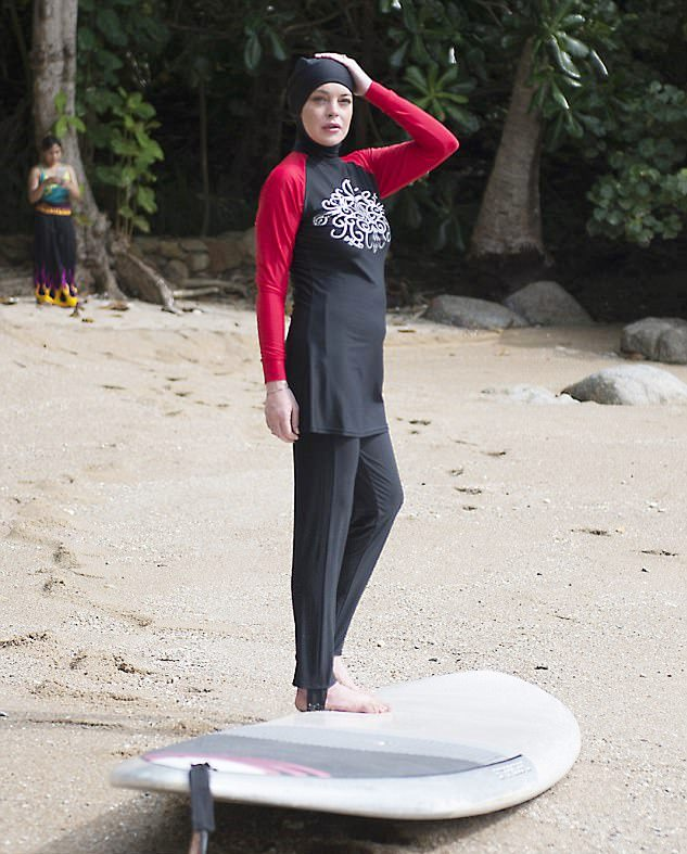 Lindsey Lohan, doing the entire world a favor by wearing the Muslim burkini.